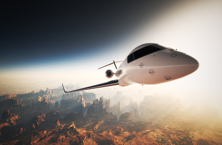 sunset sky: Photo White Glossy Luxury Generic Design Private Jet Flying in Sky under Earth Surface.Grand Canyon Background Sunset. Business Travel Image.Horizontal,Right Angle View.Film Effect. 3D rendering