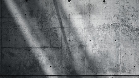 Horizontal Photo Blank Grungy Smooth Bare Concrete Wall with Sunrays Reflecting on Dark Surface. Soft shadows. Empty Abstract background. Black and White.