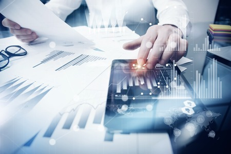 Risk Management Work process.Photo Trader working Market Report Documents Touching Screen Tablet.Using Graphic Icons,Stock Exchanges Reports. Business Project Startup. Horizontal, Flares Effect. 免版税图像