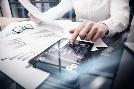 Risk Management Work process.Picture Trader working Market Report Documents Touching Screen Tablet.Using Graphic Icons,Stock Exchanges Reports. Business Project Startup. Horizontal, .