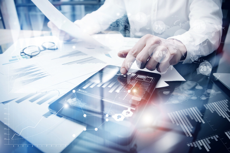 Risk Management Work process.Picture Trader working Market Report Document Touching Screen Tablet.Using Worldwide Graphic Icons,Stock Exchange Report.Business Project Startup.Horizontal,Flares Effect