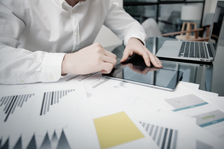 business graphics: Marketing Time Management. Work process.Photo Trader working Market Report Documents Touching Tablet,Reflections Screen.Using Graphics,Stock Exchanges Reports. Business Project Startup. Horizontal Stock Photo
