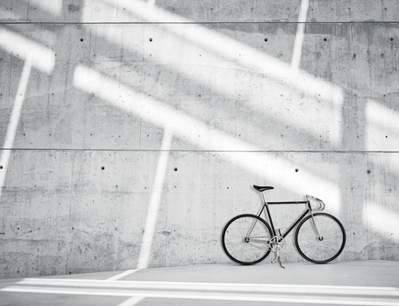 Horizontal Photo Blank Grungy Smooth Bare Concrete Wall in Modern Loft Studio with Classic bicycle. Soft Sunrays Reflecting on Surface. Empty Abstract background