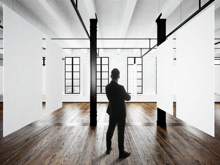hang up: Gentleman Modern museum expo loft interior.Open space studio.Empty white canvas hanging.Wood floor,bricks wall,panoramic windows.Blank frames ready for bussiness information.Horizontal mockup
