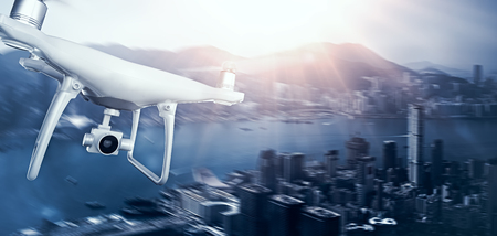 megapolis: Photo White Matte Generic Design Remote Control Air Drone with action camera Flying Sky under City. Modern Megapolis Background. Wide, front side view. Motion Blur Effect. 3D rendering