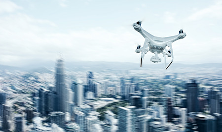 action blur: Photo White Matte Generic Design Remote Control Air Drone with action camera Flying Sky under City. Modern Megapolis Background. Horizontal, back side view. Motion Blur Effect. 3D rendering