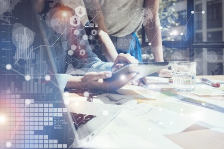 Woman Touching Screen Electronic Tablet Hand.Project Managers Researching Process.Business Team Working New Startup modern Office.International Digital Diagrams Interfaces.Analyze market stock.Blurred Archivio Fotografico