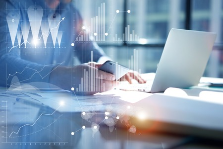 Man Typing Laptop,use Smartphone Hand.Project Manager Researching Process.Business Team Work Startup modern Office.Global Strategy Virtual Icon.Innovation Graphs Interface.Analyze market stock.Blurred