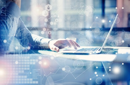 Man Typing Keyboard Laptop Hand.Project Manager Researching Process.Business Team Working Startup modern Office.Global Strategy Virtual Icon.Innovation Graphs Interfaces.Analyze market stock.Blurred