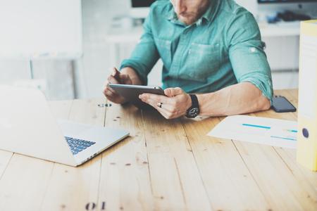insider: Social Trading Online manager working wood table laptop Modern Interior Design Loft Place.Businessman Work Coworking Studio.Men Using Digital Tablet Market Reports.Blurred Background.Business Startup