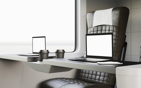 first class: Black Modern Laptop Blank Screen Table Inside Interior First Class Cabin Fast Speed Train.Empty Window Generic Design Background Coffee Cups.Clear White Display Business Mockup.Crops.3d rendering