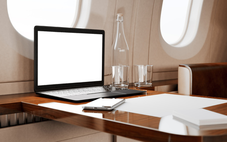 private airplane: Modern Black Laptop Blank Screen Wood Table Inside Interior Luxury Private Airplane Jet.Empty Cabin Window Generic Design Notebook.Clear White Display Business Information.Crops Mockup.3d rendering Stock Photo