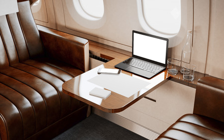 private airplane: Modern Laptop Blank Screen Inside Interior Wood Table Luxury Private Airplane Jet.Empty Leather Chair Generic Design Notebook.Clear White Display Ready Business Information.Crops Mockup.3d rendering