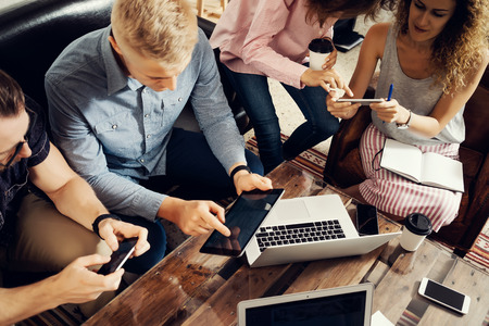 Group Young Coworkers Making Great Business Decisions.Creative Team Discussion Corporate Work Concept Modern Studio Loft.New Startup Marketing Idea Presentation.People Touching Screen Digital Gadgets Stock Photo