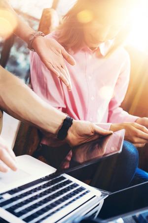 通信: Young Coworkers Group Analyze Meeting Report Process.Business Woman Virtual Startup Marketing Project.Creative People Making Great Work Decisions Modern Office Tablet Screen.Closeup Blurred Background 写真素材