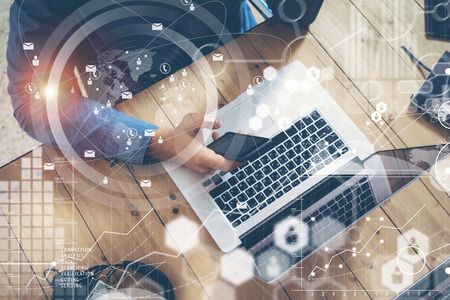 Businessman Working Startup Wood Table Laptop Modern Office.Man Work Coworking Loft.Global Connection Virtual Icon Graph Interfaces Screen Online.New Business Idea Researching Process.Top view