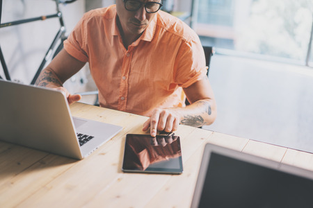 wood trade: Marketing Trade Manager Working Wood Table Laptop Modern Interior Design Loft.Coworkers Work Office Studio.Hipster Use Notebook Digital Tablet Online Reports.Blurred Background. Business Startup Stock Photo