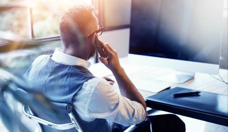 Closeup Bearded Businessman Wearing White Shirt Waistcoat Working Modern Loft Startup Computer.Creative Young Man Using Mobile Phone Call Business Meeting.Person Work Digital Tablet Desktop Table Zdjęcie Seryjne - 64805323