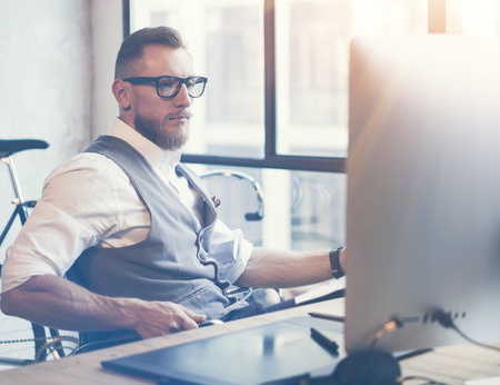 businessman in office: Stylish Bearded Young Man Wearing Glasses White Shirt Waistcoat Working Modern Office Startup Project.Creative Guy Using Desktop Computer Digital Drawing Tablet Workplace.Horizontal Blurred