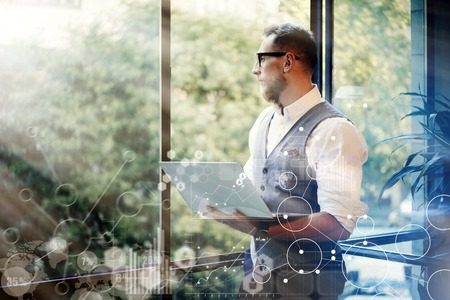 Concept Global Strategy Virtual Icon Diagram Graph Interface Investments Reserch.Bearded Businessman Searching Great Business Decisions.Young Man Holding Laptop Hands Looking Panoramic Window.Blurred