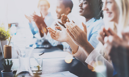 Photo of partners clapping hands after business seminar. Professional education, work meeting, presentation or coaching concept.Horizontal,blurred background