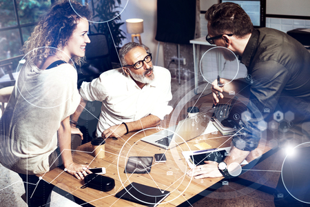 Concept of digital screen, virtual connection icon,diagram, graph interfaces.Bearded man talking with account director and creative manager.Business people meeting photo.Horizontal blurred