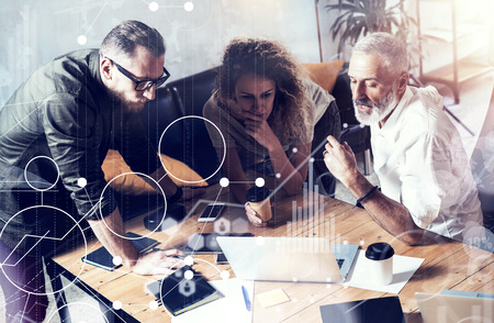 Concept of digital screen,virtual connection icon,diagram,graph interfaces. Business people brainstorming photo.Bearded man talking with account director and creative manager.Horizontal,blurred