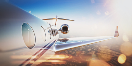 Business travel concept.Generic design of white luxury private jet flying in blue sky at sunset.Uninhabited desert mountains on the background.Horizontal,flares effect. 3D rendering