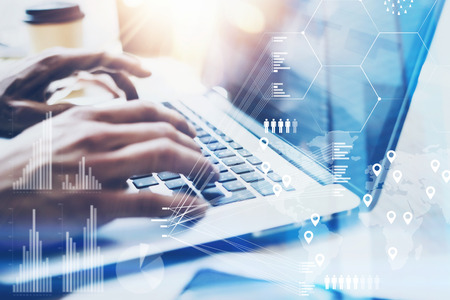 Closeup view of Male hand typing on laptop keyboard.Businessman working at office on modern notebook.Concept of digital diagram,graph interfaces,virtual screen,connections icon.Blurred. Banque d'images