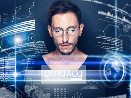 Concept of digital diagram,graph interfaces,virtual display,connections screen, online icon.Young man programmer working contemporary computer at night.Blurred background.Horizontal. Stock Photo