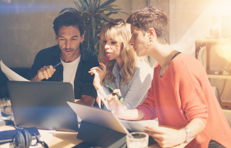 Group of coworkers making great conversation during work process in modern office.