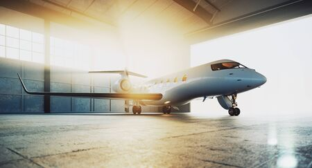 Business private jet airplane parked at maintenance hangar and ready for take off. Luxury tourism and business travel transportation concept. 3d rendering. 版權商用圖片