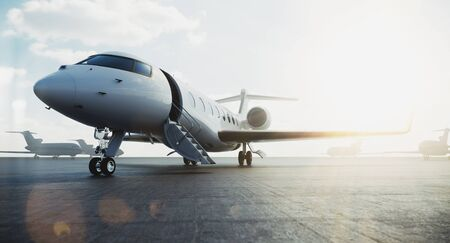 Business class jet airplane parked at airfield and waiting vip persons for take off. Luxury tourism and business travel transportation concept. Flares. 3d rendering. Imagens