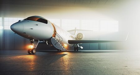Business private jet airplane parked at maintenance hangar and ready for take off. Luxury tourism and business travel transportation concept. 3d rendering. Imagens