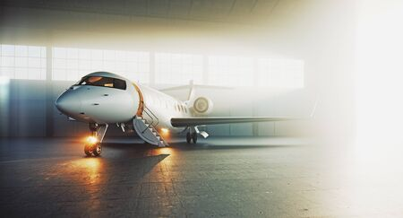 Business private jet airplane parked at maintenance hangar and ready for take off. Luxury tourism and business travel transportation concept. 3d rendering. 写真素材