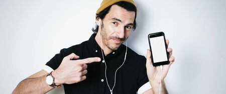 Portrait of a man showing smartphone with blank screen
