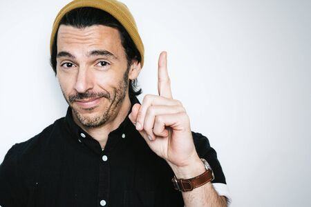 Portrait of a handsome man pointing finger up 写真素材