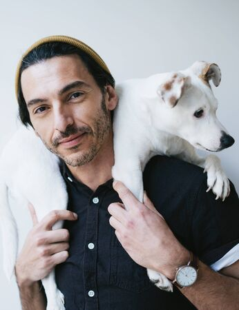 Portrait of a man with his dog 写真素材