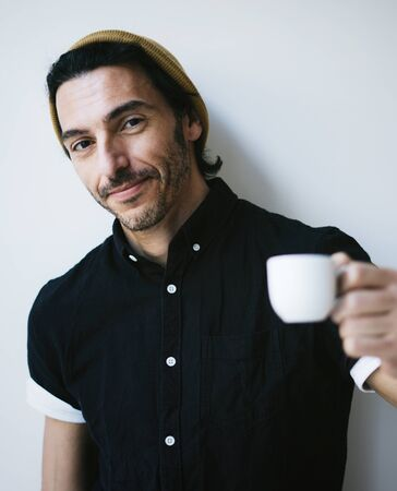 Portrait of an attractive guy with cup of coffee 写真素材 - 135712674