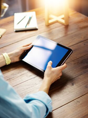 Woman pointing on digital tablet screen, chatting in social networks, meeting website, searching internet, sending sms, using text messenger or online banking. Close up of female hands holding device 写真素材 - 138548353