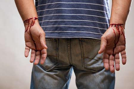 male hands, drawn cut veins and blood. 版權商用圖片