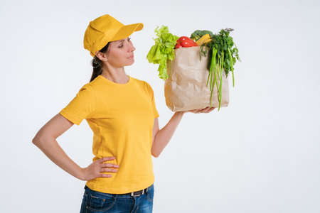 Female food delivery worker with food package.