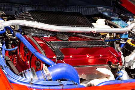Turbocharged engine on a sports car, close-up under the hood