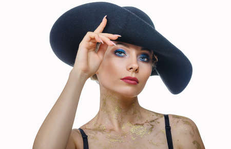 portrait of beautiful woman in with make-up in black hat on white background, isolated 版權商用圖片