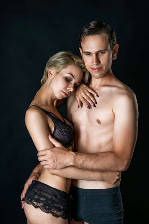 cute couple girl and guy in underwear on black background