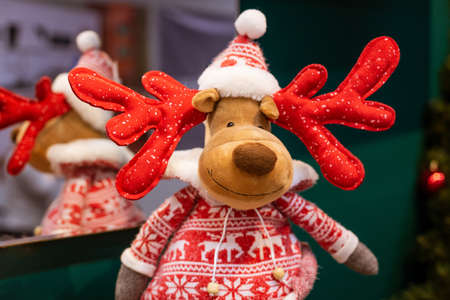 Soft toy Christmas deer close-up, in a red knitted sweater. The concept of holiday decorations Stok Fotoğraf