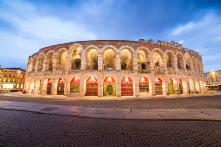 italy street: Verona amphitheatre, completed in 30AD, the third largest in the world, at dusk time. Roman Arena in Verona, Italy
