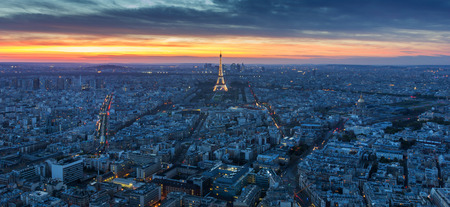 PARIS - MAY 1 : Eiffel Tower brightly illuminated at dusk on May 1 2013 in Paris. The Eiffel tower is the most visited monument of France.