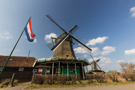 zaanse: Traditional Dutch old wooden windmill in Zaanse Schans Stock Photo
