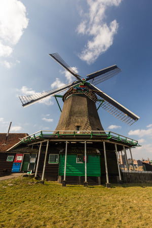 dutch typical: Traditional Dutch old wooden windmill in Zaanse Schans Stock Photo